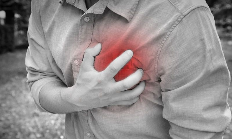 bigstock-Man-having-chest-pain-heart-100982432