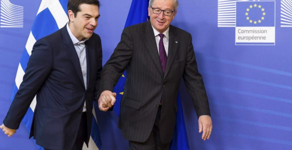 European Commission President Jean-Claude Juncker, right, walks hand in hand with Greece's Prime Minister Alexis Tsipras upon his arrival at the European Commission headquarters in Brussels Wednesday, Feb. 4, 2015. Tsiparis is on a one day trip to Brussels to meet with EU leaders.(AP Photo/Geert Vanden Wijngaert)